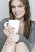 Woman enjoying a coffee — Stock Photo