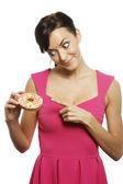 Woman with doughnut — Stock Photo