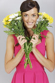 Woman with two bunches of flowers — Stok fotoğraf