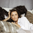 Woman on her bed — Stock Photo