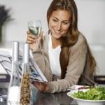 Woman reading a recipe book — Stock Photo