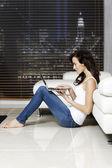 Woman working on laptop — Stock Photo