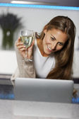 Woman using laptop at home — Stock Photo