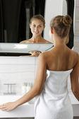 Woman getting ready in bathroom — Stock Photo