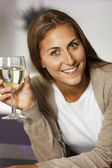 Woman enjoying a glass of wine — Stockfoto