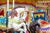 Horses on a carnival Merry Go Round — Stock Photo
