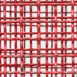Background of red steel grating — Stock Photo