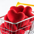 Closeup many red hearts in shopping cart — Stock Photo #32642943
