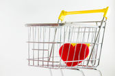 One red heart in shopping cart — Stock Photo