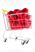 Shopping cart and many red hearts — Stock Photo