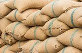 Many rice sacks in row perspective — Stock Photo