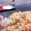Fried rice with pork on spoon — Stock Photo