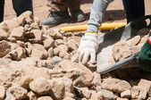 Hand picked the stones for construction — Stock Photo