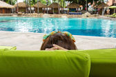 Women relaxing near poolside — Stock Photo