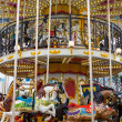 Wide view merry go round in carnival — Stock Photo #32858935