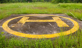 Helipad on jungle closeup — Stock Photo