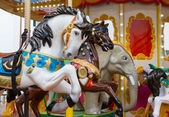 Animal seat in Merry go round at carnival — Stock Photo