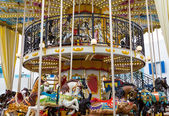 Wide view merry go round in carnival — Stock Photo