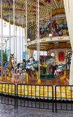 Merry go round in amusement park — Stock Photo