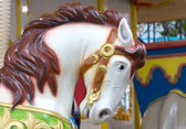 Head of white horse in merry go round at carnival — Stock Photo