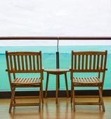 Sea view from balcony with chairs and table — Stock Photo