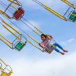 Unidentified girl on the chain swing carousel — Stock Photo