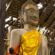 Monk care yellow robe of buddhist statue — Stock Photo