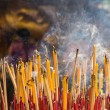 Group incense with candle and statue in horizontal background — 图库照片