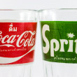Постер, плакат: Coca Cola and Sprite classic logo on empty glass