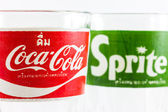 Coca-Cola foreground and Sprite background classic logo on empty — Stock Photo