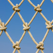 Stock Photo: Pattern rope mesh on blue sky