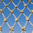 Stock Photo: Pattern rope mesh horizontal on blue sky