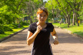 Young women with concentrated exercise by jogging — Stock fotografie
