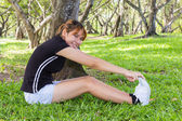 Young women happiness with stretching her legs — Stock Photo