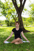 Young women exercise yoga with cross legged — Stock Photo