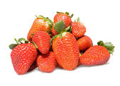 A group of strawberries on white background — Stock Photo