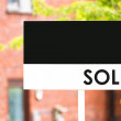 Stock Photo: Estate agent house sold sign