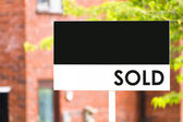 Estate agent house sold sign — Stock Photo