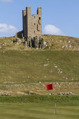 Dunstanburgh Castle Tower above golf course — Stock Photo