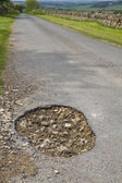 Close up of a large pot hole — Stock Photo