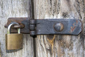 Close up of padlock and old metal hasp and staple — Stock Photo
