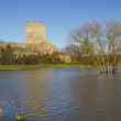Stock Photo: Flood water surrounding Tewksbury Abbey