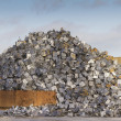 Scrap yard with pile of crushed cars — Stock Photo