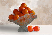Fruit bowl with tangerines — Stock Photo