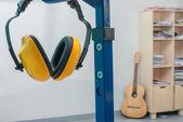 Yellow working protective headphones — Stock Photo