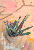 Closeup of many paint brushes in cup — Stock Photo