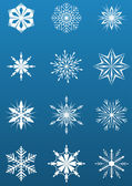White snowflake shapes on blue background — Stock Vector