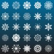 Snowflakes vector collection isolated on dark blue background. - Stock Vector