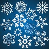 Conjunto de copos de nieve vector aislado sobre fondo azul. — Vector de stock