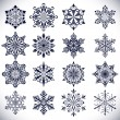 Ornate snowflake shapes isolated on white background. — Stock Vector